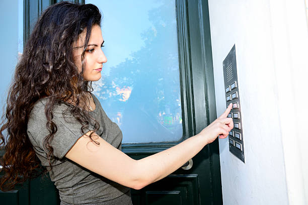 woman-ringing-door-bell-apartment-building-picture-id528219631-1