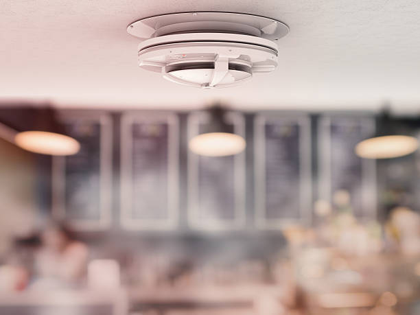 smoke-detector-on-ceiling-picture-id612375900-1